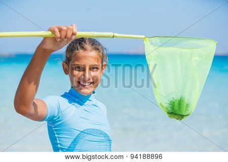 Girl playing in the sea