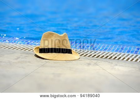 Sun Hat On The Edge Of The Pool