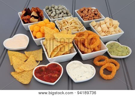 Crisp and dip party food selection in porcelain bowls.