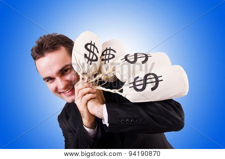 Man with money sacks against the gradient
