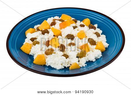 Granular Curd In Blue Glass Plate With Peaches And Raisins