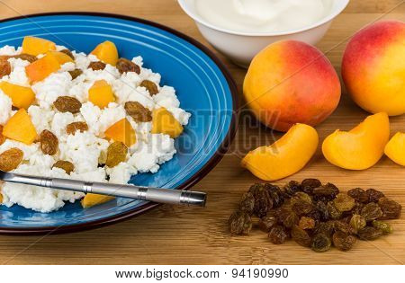 Close Up Of Curd With Peaches And Raisins, Sour Cream