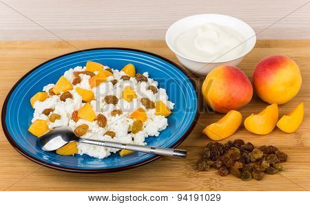 Grainy Curd With Peaches And Raisins, Bowl With Sour Cream