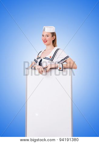Woman sailor with blank board against the gradient