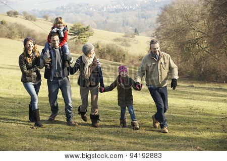 3 Generation family on country walk in winter