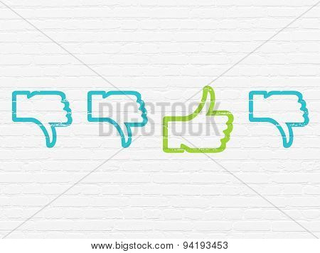 Social network concept: thumb up icon on wall background