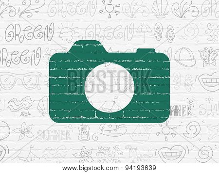 Travel concept: Photo Camera on wall background