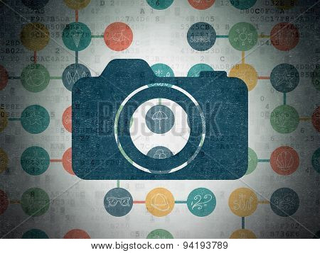 Tourism concept: Photo Camera on Digital Paper background