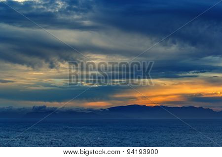 Sunset Over The Sea With A Storm Approaching