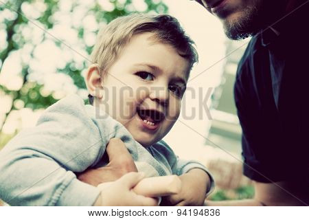 Son with father, happy moments together. Happy childhood. Vintage