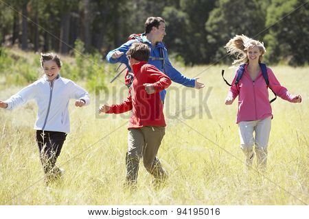 Family On Hike In Beautiful Countryside