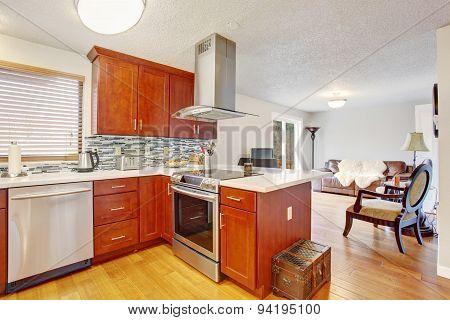 Well Kept Kitchen With Hardwood Floor.