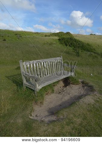 Bench Within Sand Dune Landscape