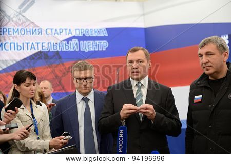 ST. PETERSBURG, RUSSIA - JUNE 20, 2015: General director of JSC Rosseti Oleg Budargin (center) talk with press during the presentation of the project of Federal Test Center for electrical equipment