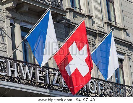 Flags On The Schweizerhof Hotel Building Facade