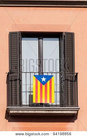 Flag Of Catalonia On The Balcony