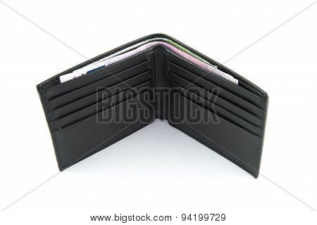 Black leather wallet with full of cash
