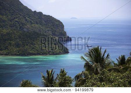 Yacht Sailing Into A Lagoon