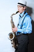 picture of saxophones  - Young expressive musician playing the saxophone - JPG