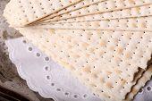 stock photo of matzah  - Matzo for Passover on table  close up - JPG