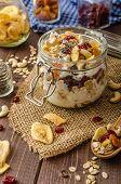 foto of dry fruit  - Homemade yogurt with granola dried fruit and nuts bio  - JPG