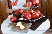 foto of serving tray  - Tasty ripe apples on serving tray on table on wooden background - JPG
