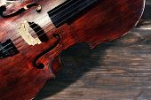 foto of cello  - Vintage cello on wooden background - JPG