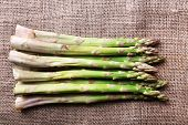 picture of sackcloth  - Fresh asparagus on sackcloth background - JPG