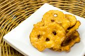 stock photo of pretzels  - Pretzel crackers on bamboo tray - JPG