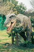 image of carnivorous plants  - ancient extinct dinosaur on a background of plants - JPG