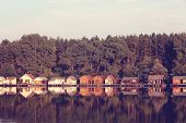 foto of house woods  - Capture of Colorful and beautiful houses on lake - JPG
