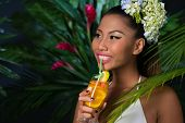 picture of filipina  - Attractive girl on the background of tropical forest drinking fresh cocktail - JPG