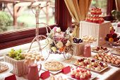 picture of sugarpaste  - Capture of Table setting with flowers and sweets - JPG