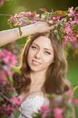 pic of allergies  - Young spring fashion woman in spring garden Springtime Summertime Trendy girl in the flowering trees in then at sunset in spring summer landscape background Allergic to pollen of flowers Allergy  - JPG