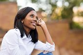 pic of daydreaming  - beautiful african college student daydreaming on campus - JPG