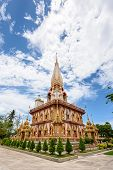 stock photo of worship  - Beautiful pagoda at Wat Chalong or Wat Chaitararam Temple famous attractions and place of worship in Phuket Province Thailand - JPG