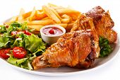 foto of thighs  - Grilled turkey thighs with chips and vegetables  - JPG