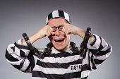 stock photo of prison uniform  - Funny prisoner in chains isolated on gray - JPG
