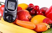 picture of immune  - Glucometer with fresh ripe fruits and vegetables concept of diabetes healthy food nutrition and strengthening immunity - JPG