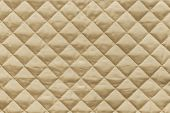 picture of quilt  - golden quilted synthetic fabric with grained texture for empty and pure abstract backgrounds - JPG