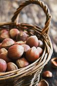foto of cobnuts  - hazelnuts in a basket on an old wooden background - JPG