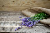 pic of sackcloth  - lavender fresh bunch on wooden and sackcloth background - JPG