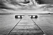 stock photo of rain clouds  - Old wooden jetty - JPG