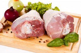foto of turkey-hen  - Raw turkey legs on cutting board  - JPG