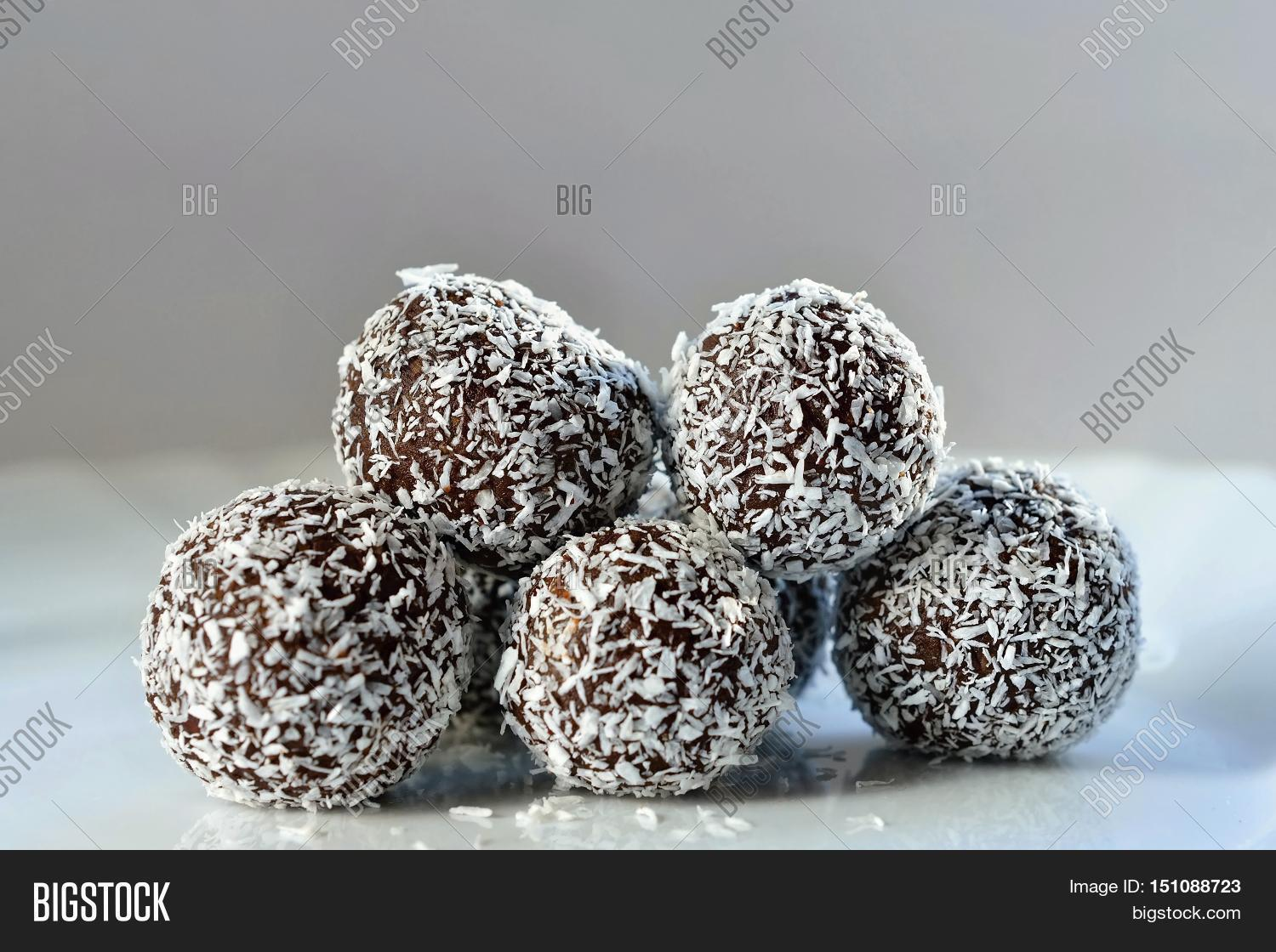 Homemade coconut rum balls on plate. Christmas sweets ...
