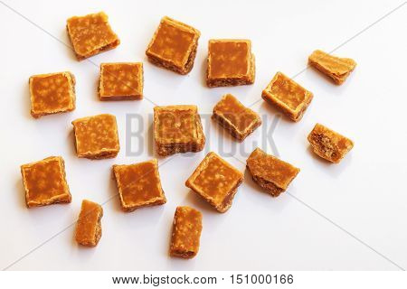 Salted caramel pieces and sea salt. Golden Butterscotch toffee caramels. Toffees.