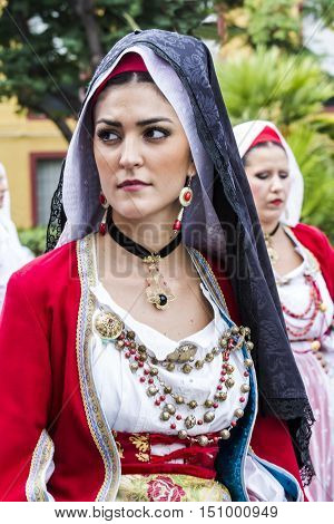 SELARGIUS, ITALY - September 13, 2015: Former marriage Selargino - Sardinia - portrait of a beautiful girl in traditional Sardinian costume