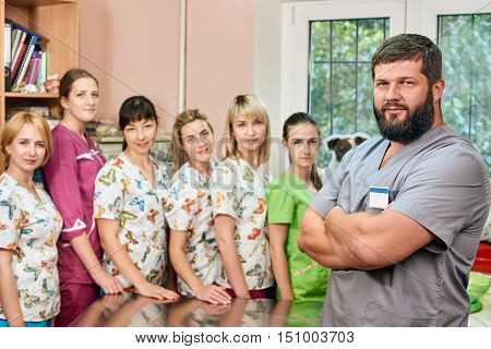 Group of doctors at the vet clinic headed by a man