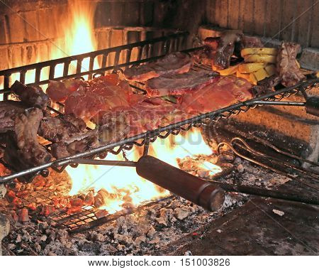 Hot Fire To Cook Pork Ribs And Tasty Spicy Sausage Grilled