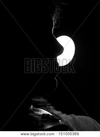 very atmospheric backlighting of a profile with the mouth and nose of a beautiful woman in the bedroom